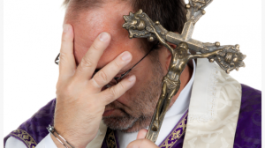 Priest-in-handcuffs-via-Shutterstock.com_-615x345