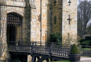 A drawbridge over a moat to a castle.