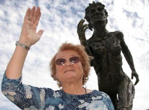 The original nymph, Geneice Scott, standing in front of a nymph statue in Adelaide in 2007. [Image crecit: perthnow.com.au]