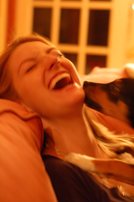 puppy_licking_laughing_woman