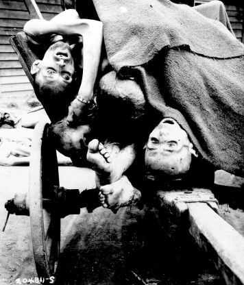 800px-Some_of_the_bodies_being_removed_by_German_civilians_for_decent_burial_at_Gusen_Concentration_Camp,_Muhlhausen,_near_Linz,_Austria