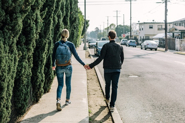 boy-girl-holding-hands-on-the-sidewalk