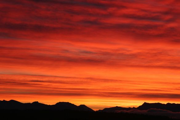 Sunrise over the Cascades, by Brad Greenlee