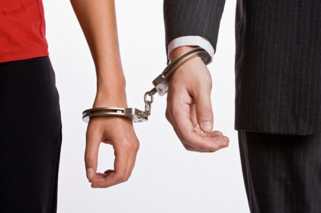 Business people handcuffed together