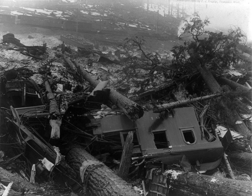 1024px-Train_wreckage_from_Wellington_WA_avalanche_cph.3b13980